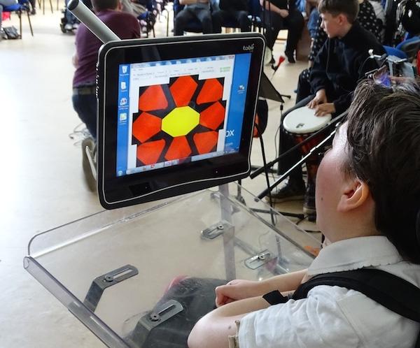 Greta plays music using her eye movements to control Eyegaze software
