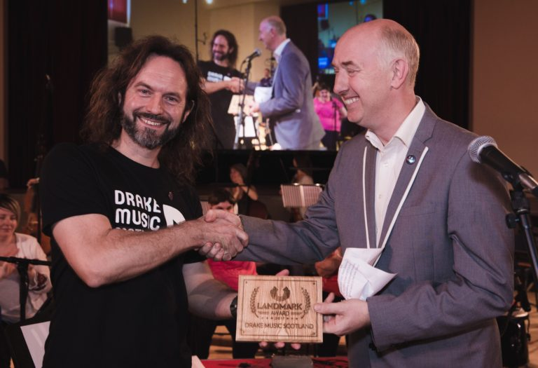 Accepting a Landmark Award by Hands Up for Trad